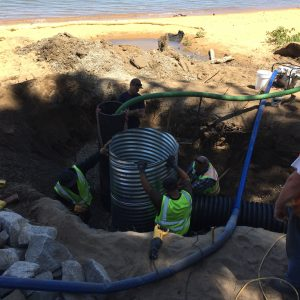 Installing the sediment can at Church Street outfall